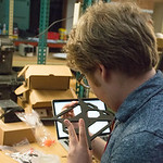 Geolaunchpad intern Dylan Blanchard assembles UNAVCO's 3D printer, which will be used to create educational models. UNAVCO Workshop, Boulder, Colorado, June 2017. (Photo/Ellie Ellis, UNAVCO) ...