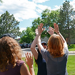 Geolaunchpad interns Amye Pedrino, Jodi Schoonover, and Elizabeth Etzel share a high-five during an afternoon leadership training designed to build their individual and group strengths. UNAV ...